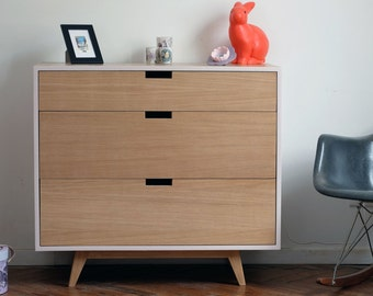 Convenient three pastel pink drawers and natural oak