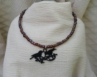 Two birds of a feather beaded necklace.