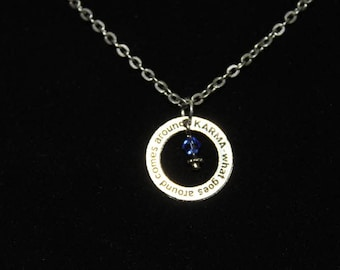 karma what goes around comes around necklace with blue crystal