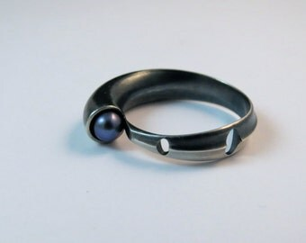 Crazy ring of the King in silver and purple Pearl