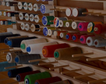 Wall display stand for 40 conical spools and 76 spools