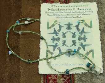 Humming bird feather medicine necklace