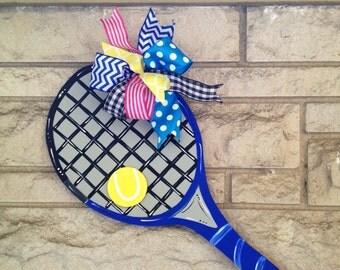 Tennis racquet door hanger