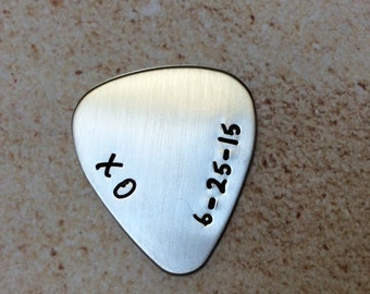 Stamped stainless steel guitar pick with personized message