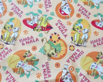 "1/2 yard of 100% cotton ""lion king"" fabric"