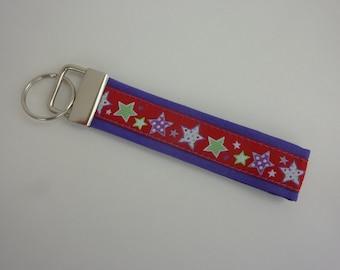 "Key ring ""Stars"" in purple/red/neon green/white"
