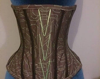 "Tron - black and green corset with circuit board print and UV stitching. 22.5"" waist"