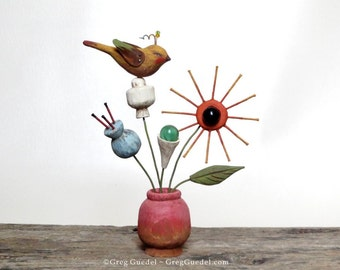 Folk art bird on flower vase sculpture