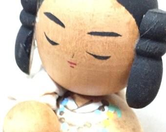 Very unusual Vintage Japanese Kokeshi girl with sack