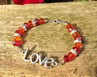 Love bracelet with clear stoned spacers in a orange and red theme