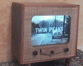Miniature TV that lights up! Put on some black coffee and bake a cherry pie, Twin Peaks is on! Agent Cooper would approve.