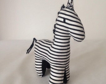 "Black & White striped Zebra // Small size made by Ugandan Disabled Women. 5"" tall and 3"" wide. Item# 1806"