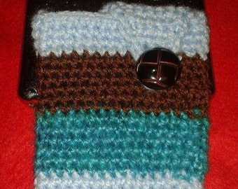 Blue mobile sleeve with brown button fastening