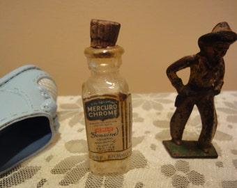 Vintage Grouping of Old Medicine Bottle/Vintage Toys/Old Iron Man Toy/Vintage Dolshoe/and Vintage Mercuro Chrome bottle