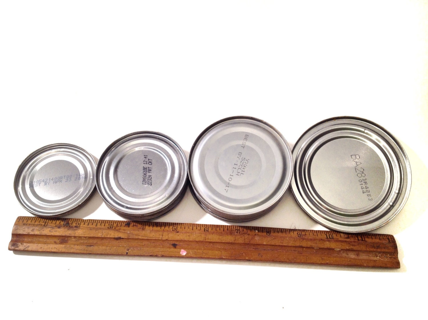Metal craft tin can lids supply industrial salvage for Metal art craft supplies
