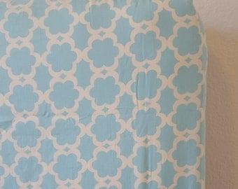Fitted Crib Sheet.  Aqua Lattice design, outlined in white.  Dena Fishbein, designer.