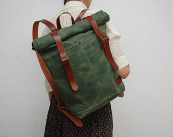 Waxed Canvas rucksack/backpack,  army color, hand waxed , with handles, leather  double closures