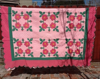 Antique pink floral quilt
