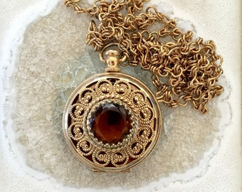 Vintage locket style gold necklace