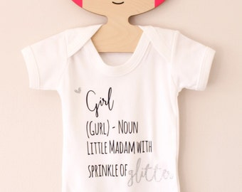 Definition of a girl navy and glitter babygrow - ages 3 months to age 2