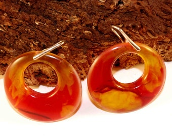 red and yellow earings with botanical form