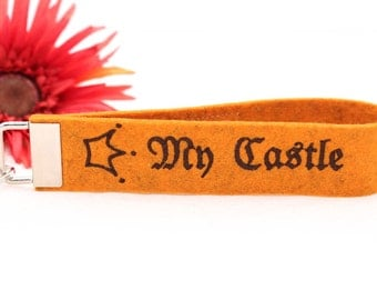 "Embroidered Keychain ""My Castle"" of orange wool felt"