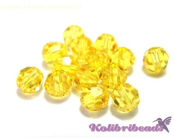 10x Swarovski 5000 Faceted Round Beads 6mm - Light Topaz
