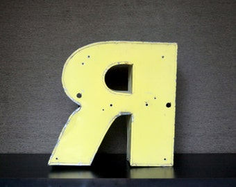 Industrial metal, letter R, yellow. Letter R. Industrial Letters. Metal Yellow Industrial neon letter Letter R.