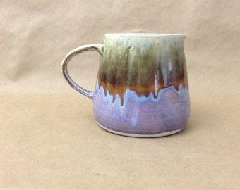 Handmade porcelain pitcher. Drippy pastel glaze.