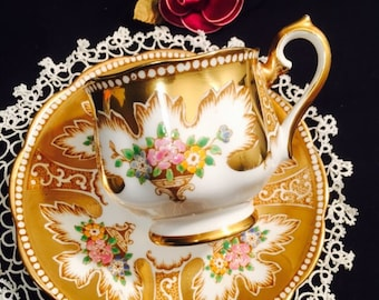 Royal Albert with rich gold pattern
