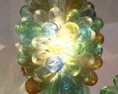 Light fixture of hand-blown glass