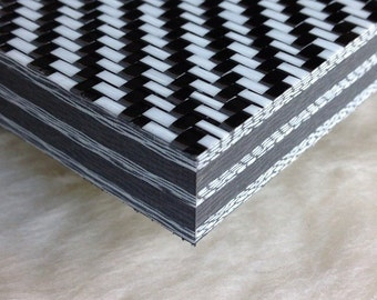 """High Quality Black and White Carbon Fiber plate 1/2"""" thick, sold per square inch"""