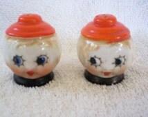 Kewpie salt and pepper shakers with star eyes and sweet faces, Japan, 1950s lusterware