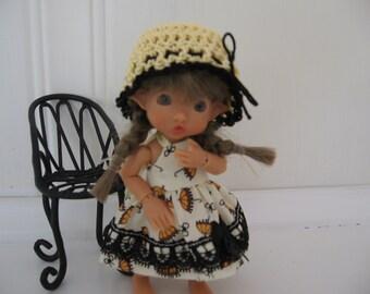 Yellow umbrella dress and hat