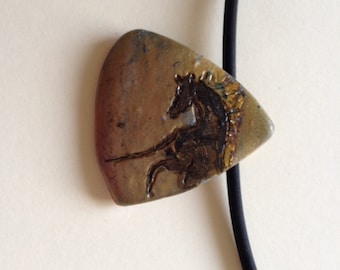 Horse with golden mane triangle polymer clay pendant.