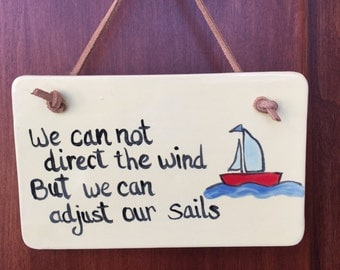 We can not control the wind, but we can adjust our sails plaque.  Yellow background with a leather cord for hanging.