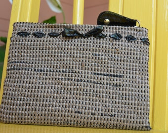 Adorable pouch handwoven out of plastic shopping bags