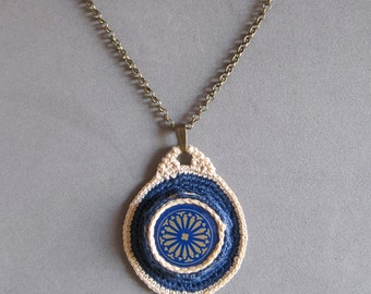 Crochet pendant with bottle cap
