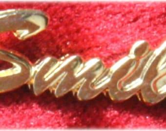 "Gold ""Smile"" Lapel Pin"