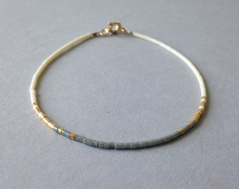 Ombre tiny delicate bracelet / Friendship beaded layering bracelet / Iridescent grey