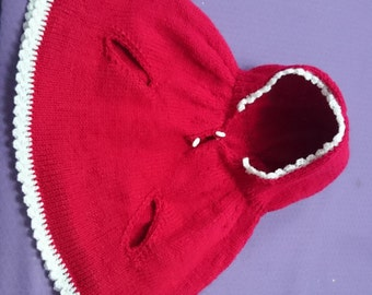 Hand-knitted baby poncho with handholes 6-12 months