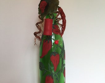 Hand painted wine bottle of chili peppers