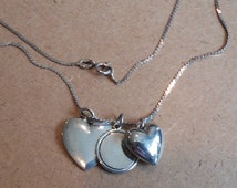"Vintage Triple Charm Heart Necklace, Sterling Silver, 22"" Chain. Signed and Stamped with TWO Antique James Avery Charms and One Puff Heart."