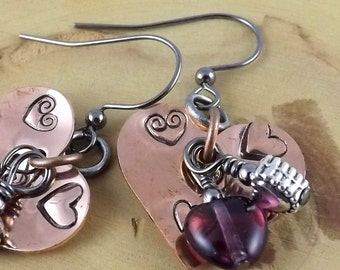 Happening Hearts purple and copper hand stamped charm earrings