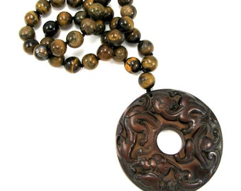 Brown cinnabar pendant necklace with iron tiger's eye on silk cord, chinese dragon motif