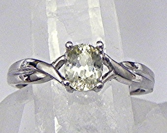 AAAA Natural Unheated Yellow Sapphire   6x5mm  .75 Carats   in a 14K white gold Infinity ring. 1991 MMMM