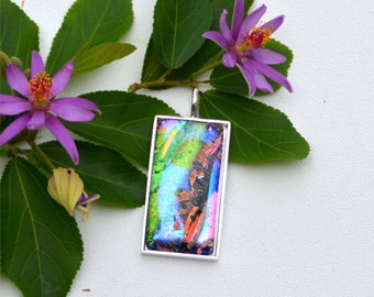 Fused dichroic glass pendant in silver plated setting, rectangle, green, blue, red
