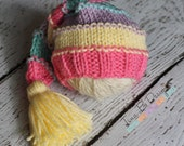 Newborn girl knit tasseled long-tail hat in pink, yellow, lavender, and aqua