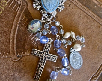 My Blue Heaven: Rosary Necklace Vintage Assemblage Choker Reworked Ice Blue and Silver Religious Medallions Silver Cross Heart Carved Lily