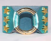 Silver Star Studded Ring Clasp Cuff  on Teal Metallic Leather support your favorite team by Rockin its Colors